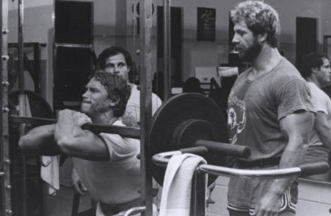 Arnold Schwarzenegger doing front squats with Franco ...