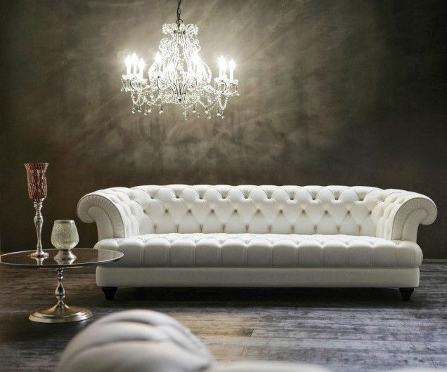 Furniture Glamour Crystal Chandelier Above Modern White Chesterfield Paired With Round Glass Table Luxurious Old Fashion Chesterfi Huisinrichting Huis Sofa S