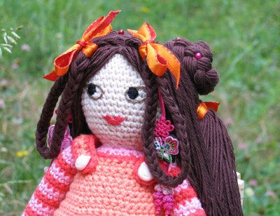Lovely embroidered features on a crochet doll!