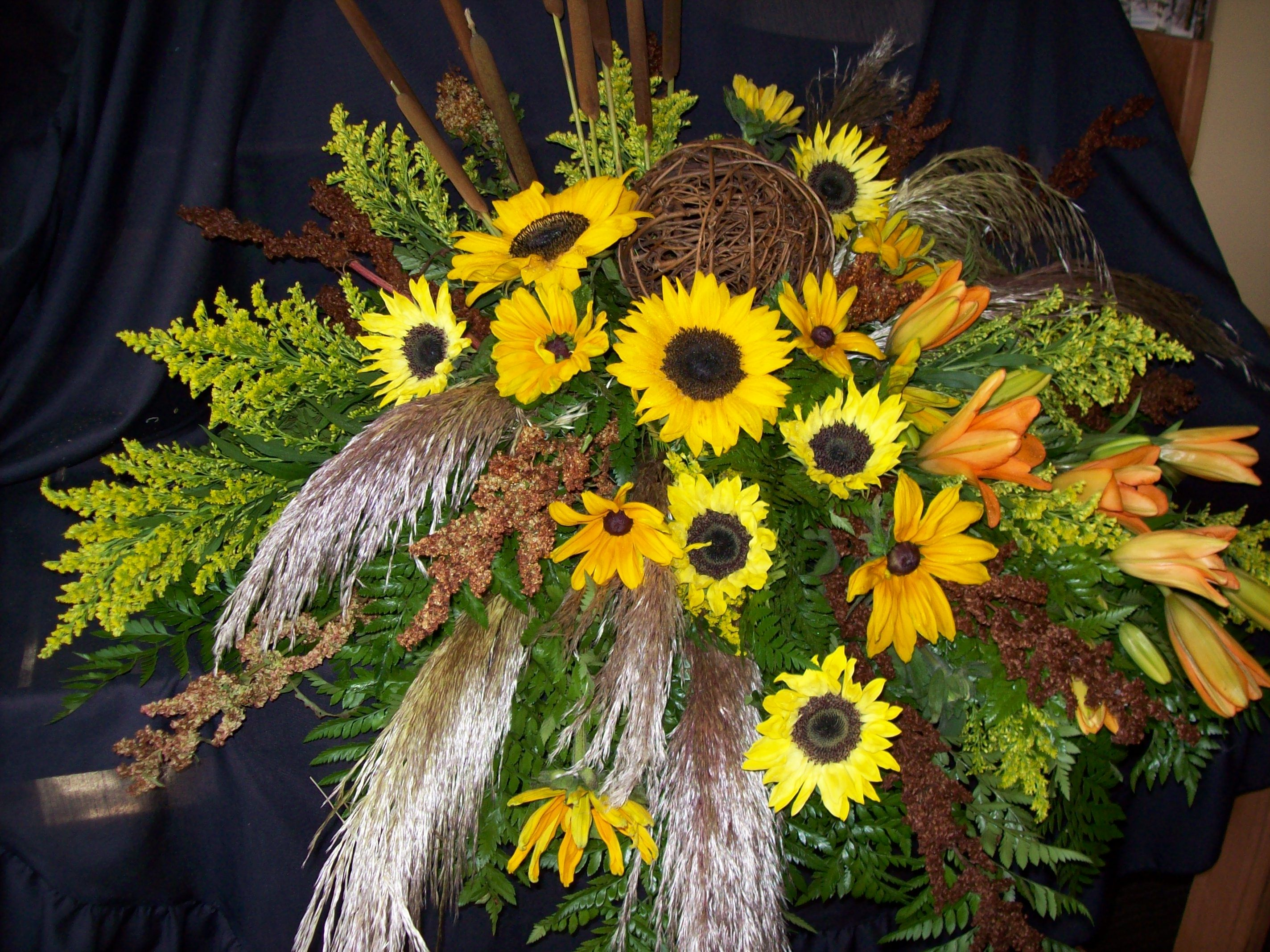 Casket spray made for a man who loved sunflowers and