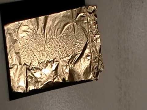 applying gold leaf on paper using a stamp and embossing. Black Bedroom Furniture Sets. Home Design Ideas