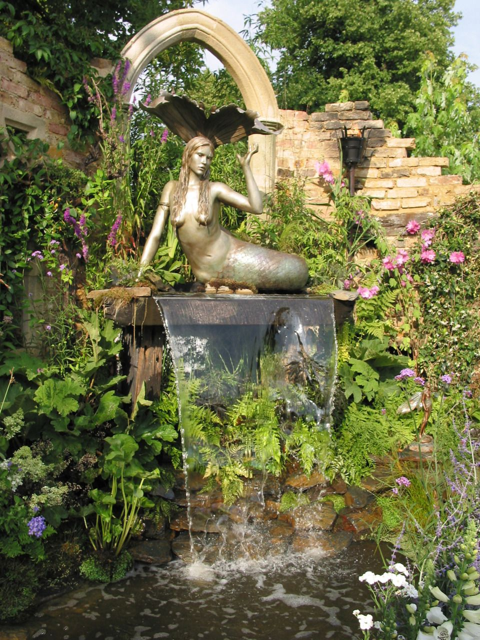 An entry from emilialua fountain and mermaid