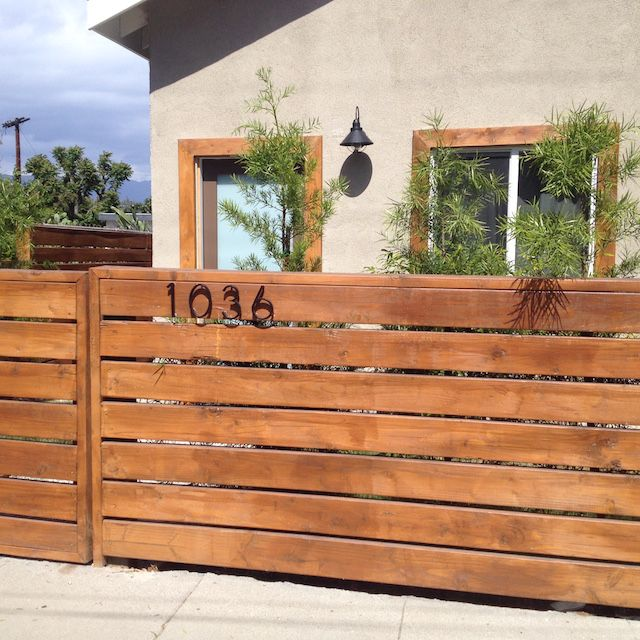 How These Wooden Fences Became A Symbol Of Gentrification Across Los Angeles Fence Design Wood Fence Design Modern Front Yard