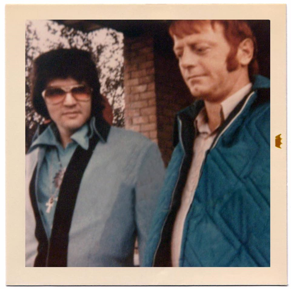 "Tony King (King Archives) shared this RARE photo with the ELVIS PICTURES group on facebook. It was taken on Friday, November 12, 1971 and shows Elvis with Robert Gene ""Red"" West (1936 - 2017). On this day Elvis performed one single show at Hofheinz Pavillion in Houston, TX (8:30 pm). Photo source: https://www.facebook.com/photo.php?fbid=10209769856871661&set=g.515244605238390&type=1&theater"