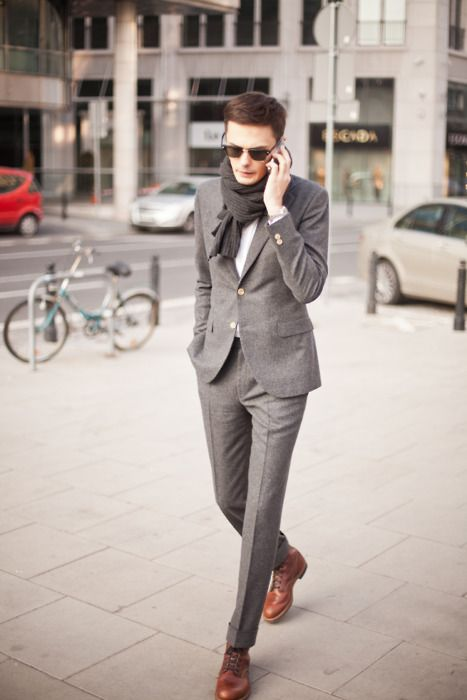 Pearl gray suit with long lean lines.