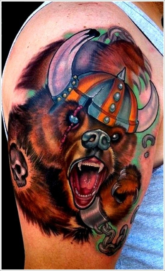 Coloured bear in viking helmet tattoo on shoulder