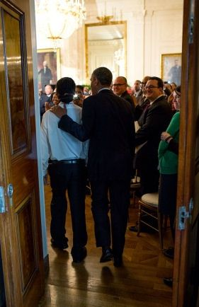President Barack Obama enters the East Room of the White House with Christian…