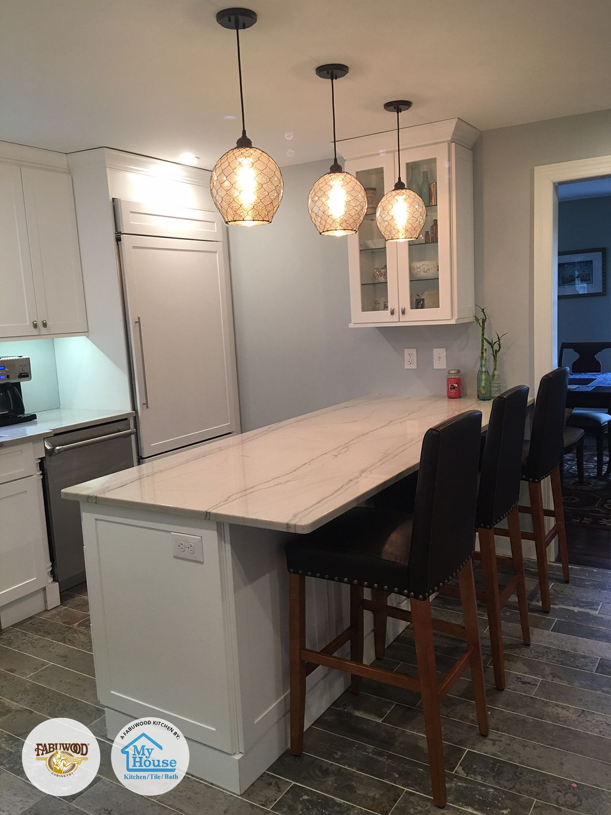 From The Beautiful Lighting To The Spectacular Backsplash My House Kitchen Tile Bath Located In Union N Kitchen Cabinetry Fabuwood Cabinets Home Kitchens