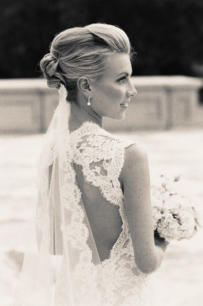Wearing veil low below hair. Love her hair and back of her dress too!