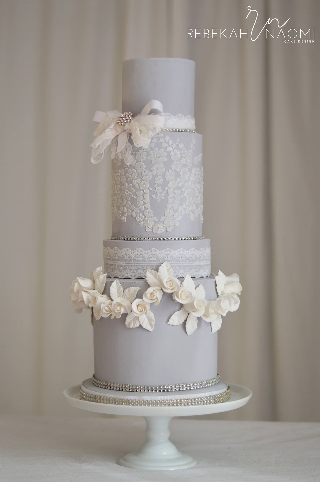 Wedding cakesoft dove grey with romantic rose swag border cakes