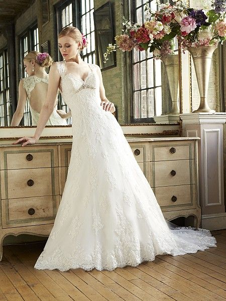 Moonlight keyhole back accents this romantic trumpet gown. soft venise lace appliques. STYLE J6284
