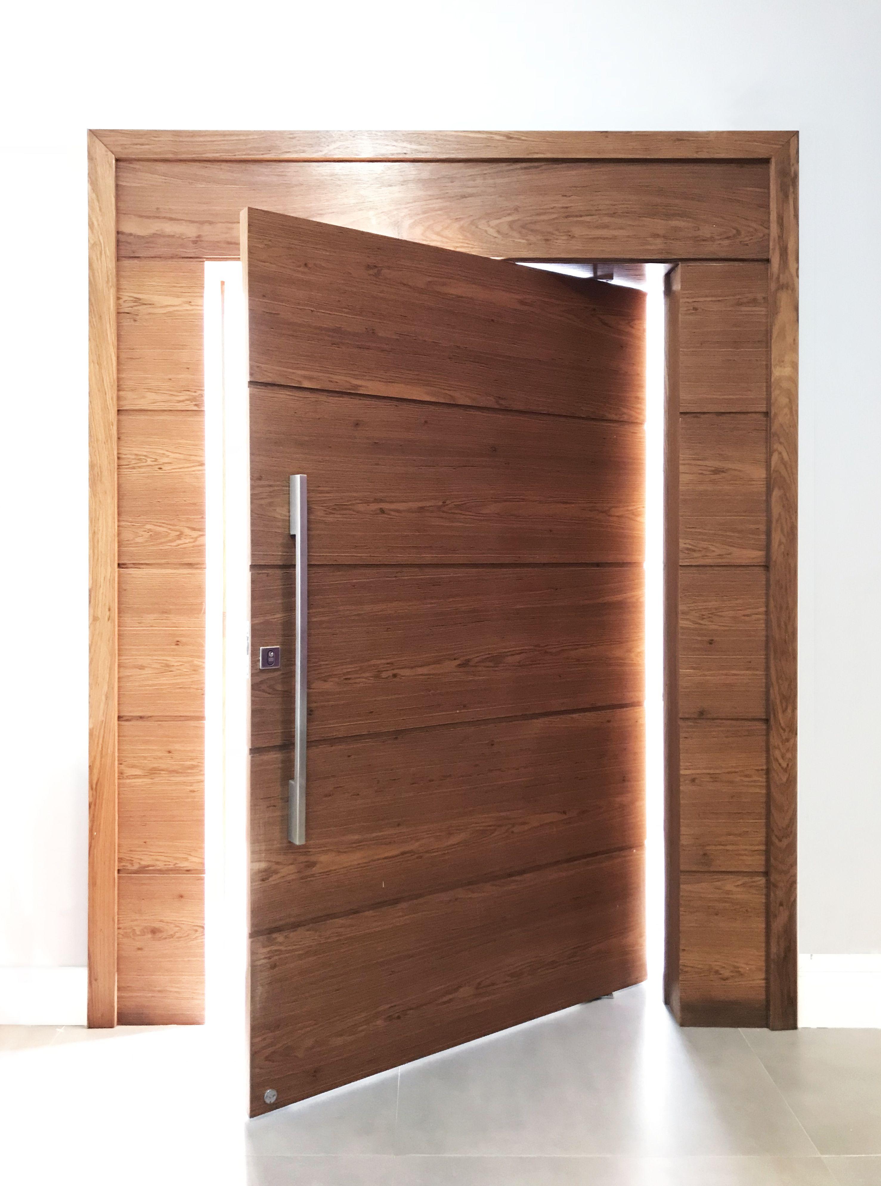Pivoting wooden door, stainless steel handle, entrance door…