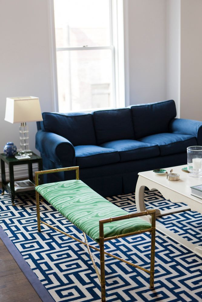 White Living Room With Navy Blue And Emerald Green Accents