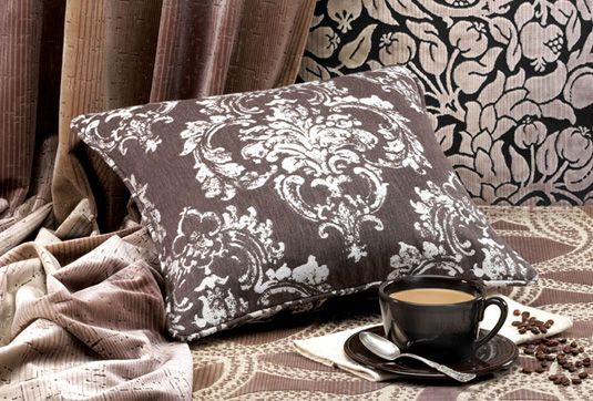 This exceptional collection of Scalamandre fabrics in rich cocoa tones adds a warm touch to any room setting. Tennant  Associates Suite 61 in MDC