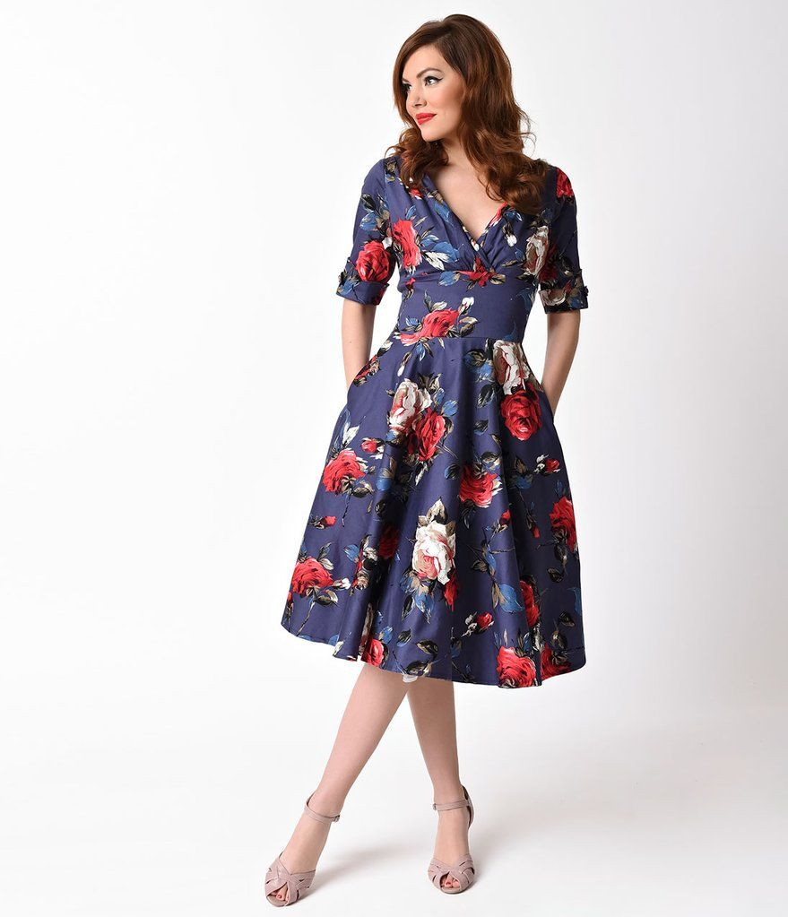 7022ca2268e7 Unique Vintage 1950s Navy & Red Floral Delores Swing Dress with Sleeves