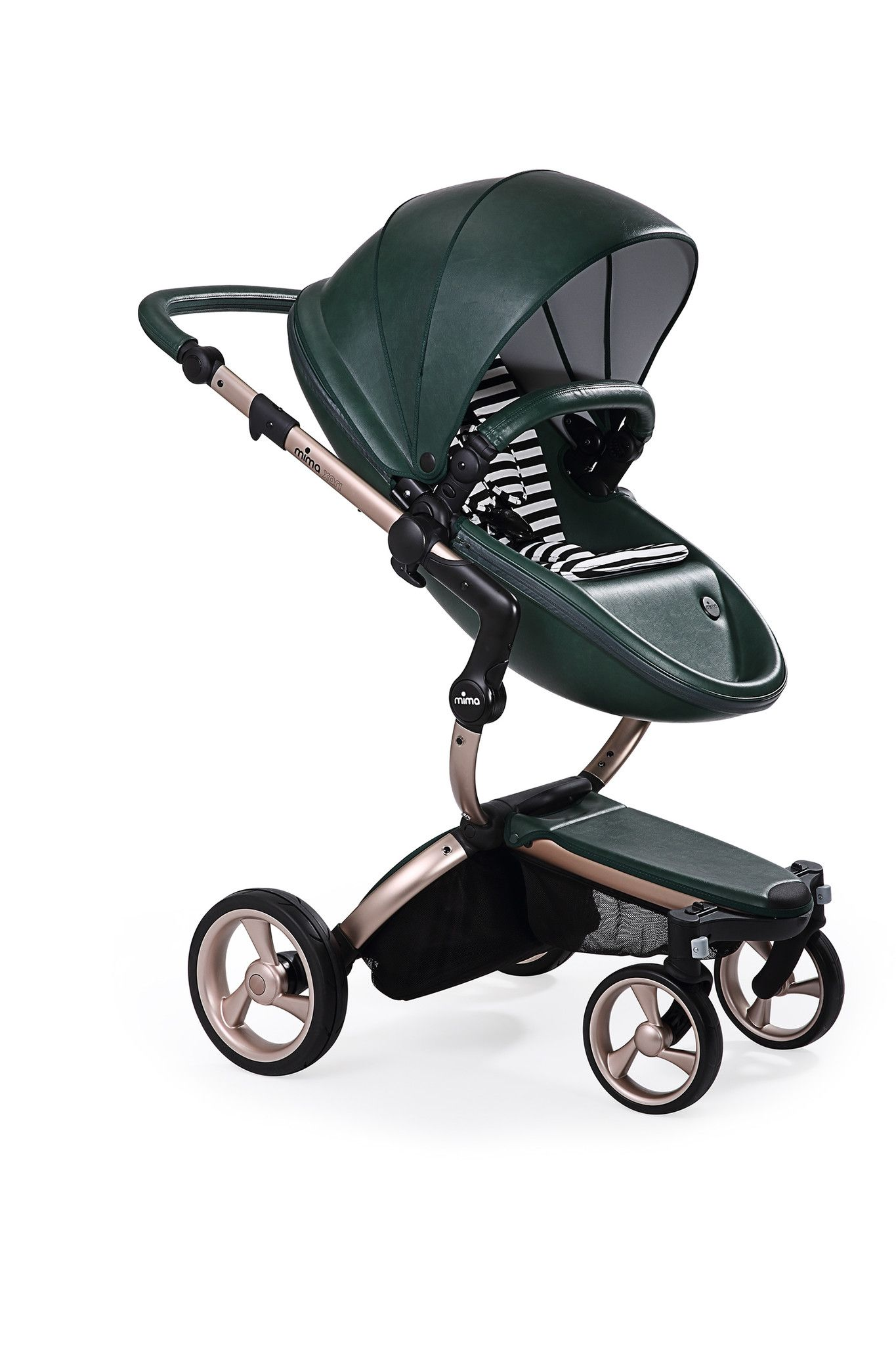 Mima Xari - British Green Seat, Black/White Starter Pack | The only stroller made with leatherette fabric, the Mima Xari is more than a pretty face. With a chic design and advanced features, this highly-customizable stroller strikes the perfect balance of fashion and functionality.