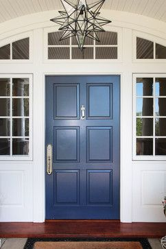 A Colonial Blue Front Door With A Moravian Star Pendant Is Warm