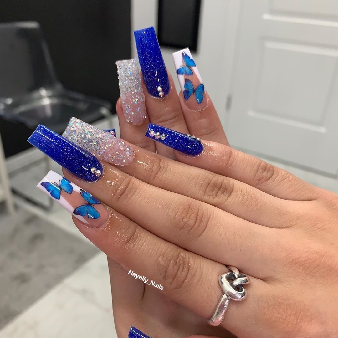 Nayelly Nails On Instagram I M Loving The Blue Butterflies Butterflynails Valentinobeaut In 2020 Blue Acrylic Nails Glitter Nails Acrylic Pink Acrylic Nails
