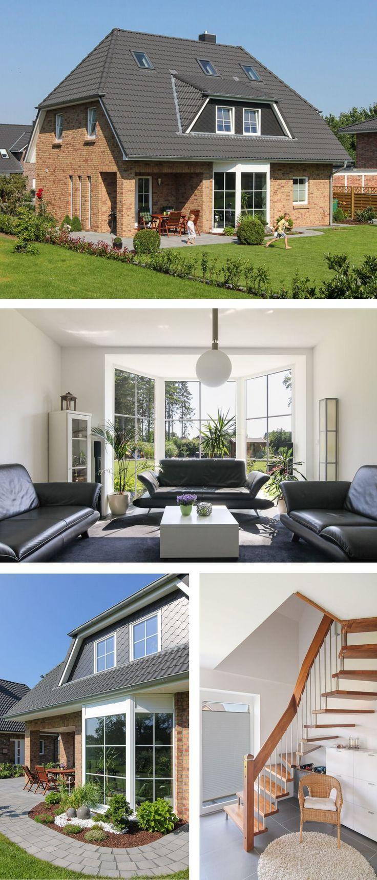 Einfamilienhaus Neubau mit Klinker Fassade, Wintergarten