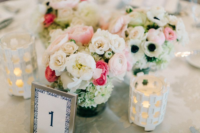 weddings - centerpieces of whites and pinks, hydrangeas, roses, teas roses, garden roses, ranunculus, anemonies, geometric candle holders.