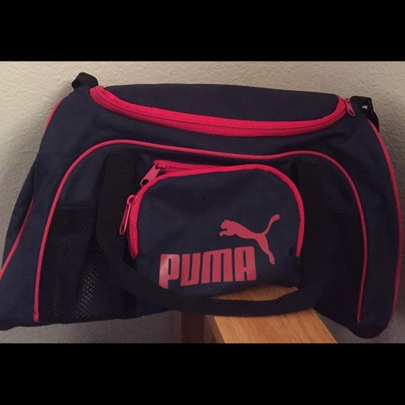 0f2431fde9 Puma duffle gym bag Puma duffle gym/travel bag. Med size. Color Navy blue  and hot pink. A couple of zipper compartments . Puma Bags Travel Bags