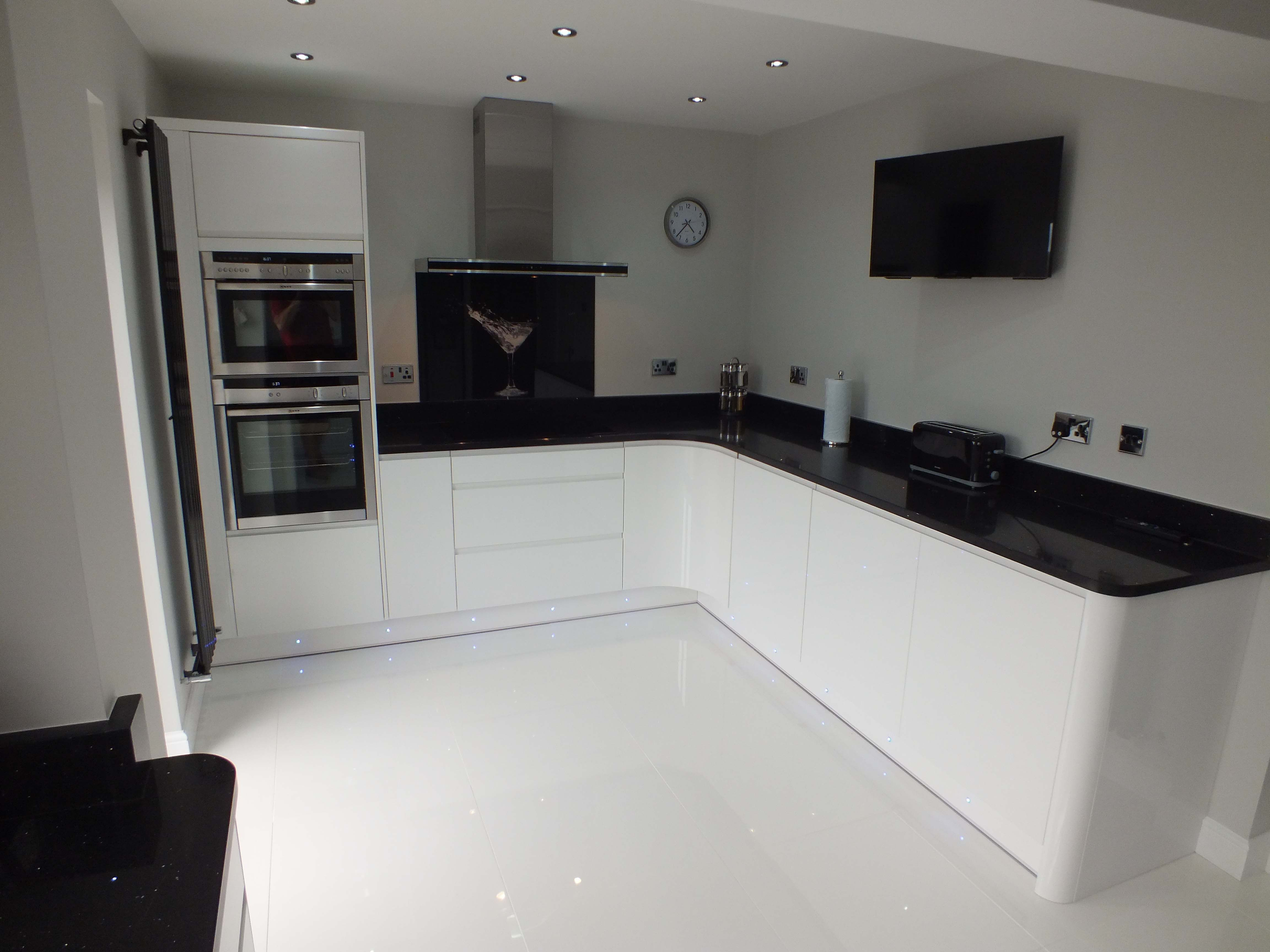 This monochrome kitchen is ultra sleek with Handleless