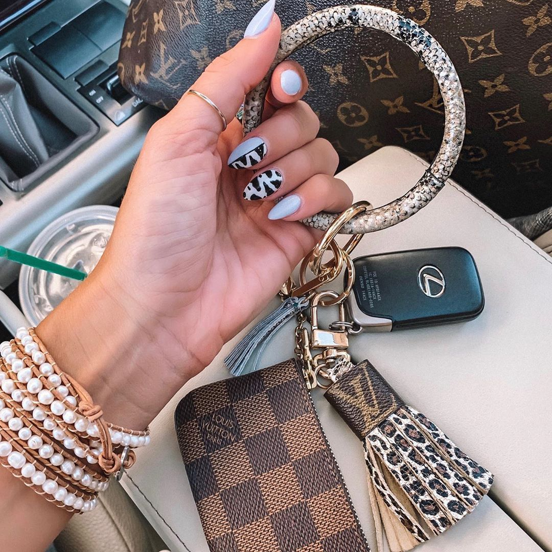 """Photo of j e n a  g r e e n's Instagram post: """"Snake print key rings, yes please! These just launched on the @shopalbpeoria website for a whopping $16! Also found a dupe of my LV key…"""""""