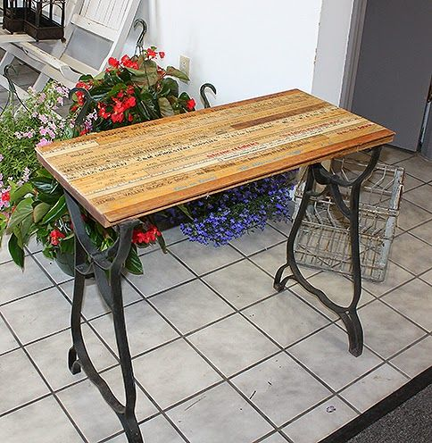 Old Wrought Iron Base With A New Upcycled Yardstick Table Top