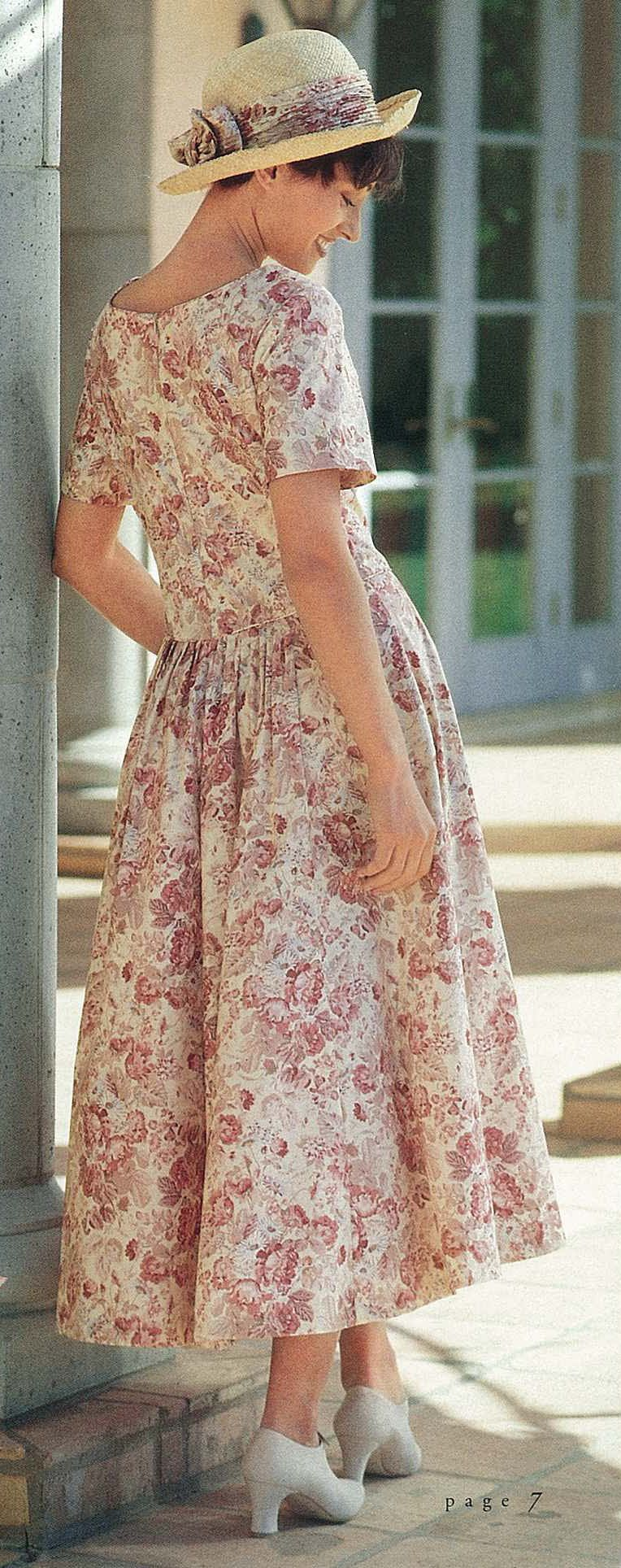 She's a natural for spring with Laura Ashley's floral trimmed straw hat matching the v-waisted cotton dress.