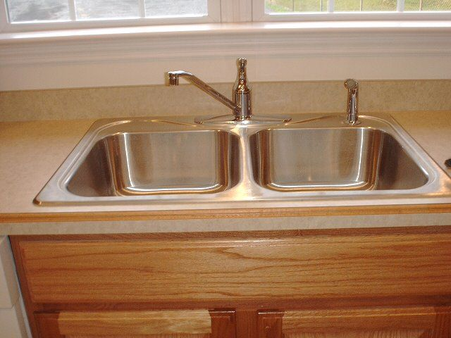 kitchen sink - Studies have shown that the most germ-laden area in a ...