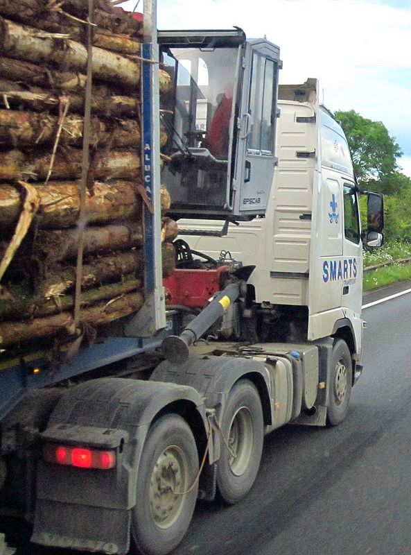 Smarts transport log lorry with all weather grab cab June 2014