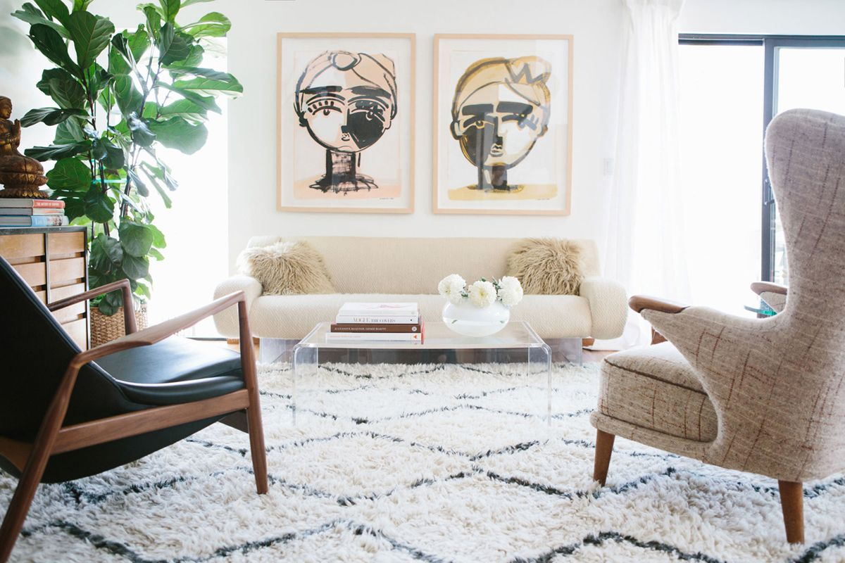a modern eclectic living room with large art and moroccan rug | via ...