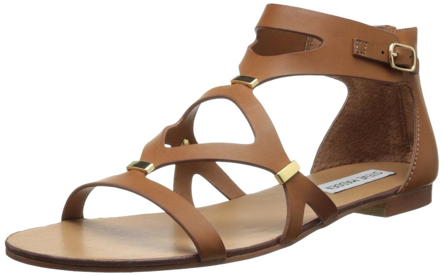 b3c748f51b1 Steve Madden release a Synthetic Women s Comma Gladiator Sandal with a man  made sole and rear zip entry with a functional buckle accent.