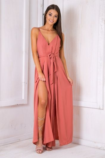 """We Love Love the """"Cooper jumpsuit - Dusty pink"""" Featuring a V-neckline and low cross over back straps,sash tie waist, lovely light fabric and split front legs.Style it with wedge heels and a poplipstick to top off the outfit for the evening! Size 8, Length: 147cm/58inches Width: 35cm/14inchesPolyester Cold Hand Wash Only Model wears a size 8 Model's height 172cm  Prints may vary Imported A slight variation may occur in colours and size specifications. Colours may appear slightly…"""