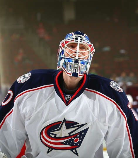 NEWARK, NJ - MARCH 19: Joonas Korpisalo #70 of the Columbus Blue Jackets looks on during pregame warmups prior to the game against the New Jersey Devils at Prudential Center on March 19, 2017 in Newark, New Jersey. (Photo by Andy Marlin/NHLI via Getty Images)