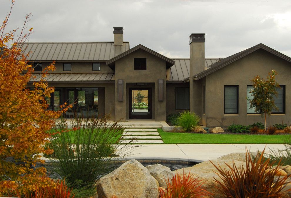 stucco finishes Exterior Farmhouse with brown exterior