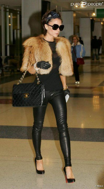 259a013a4ff78d victoria beckham. styling sexy leather leggings and the classic Chanel bag.