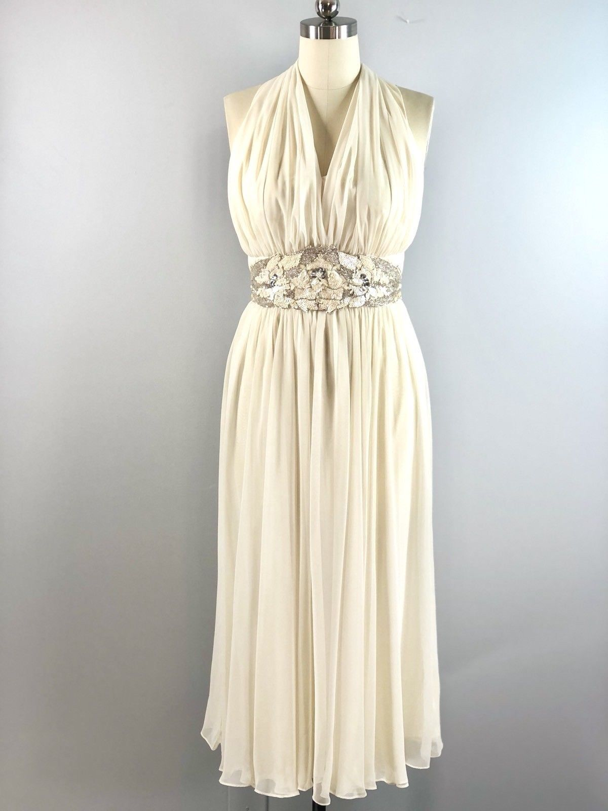 19cee4e2b71 Ivory polyester chiffon halter dress from 1970s Ursula. Gorgeous sequin  accent at waist. Gathered