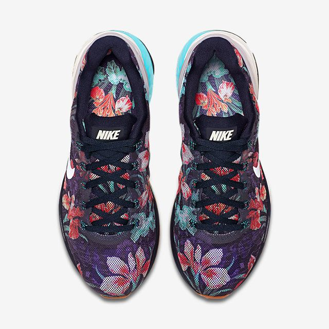 678f18b34c9c Shop Women s Nike Blue White size Athletic Shoes at a discounted price at  Poshmark. Description  Nike LunarGlide 6 Photosynthesis Pack 776260 401  Floral ...