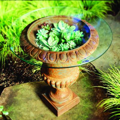 Urn and succulents as patio table:    Root succulents by putting them in an 18-inch-diameter urn filled to 6 ½ inches below the rim with potting soil, then center a 24-inch round of tempered glass ― sold as a tabletop ― on the rim. The mini-greenhouse doubles as a table for a lightly shaded patio.