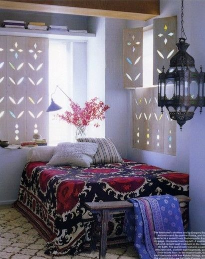 Another example of screen + stained glass instead of traditional curtains or shutters.