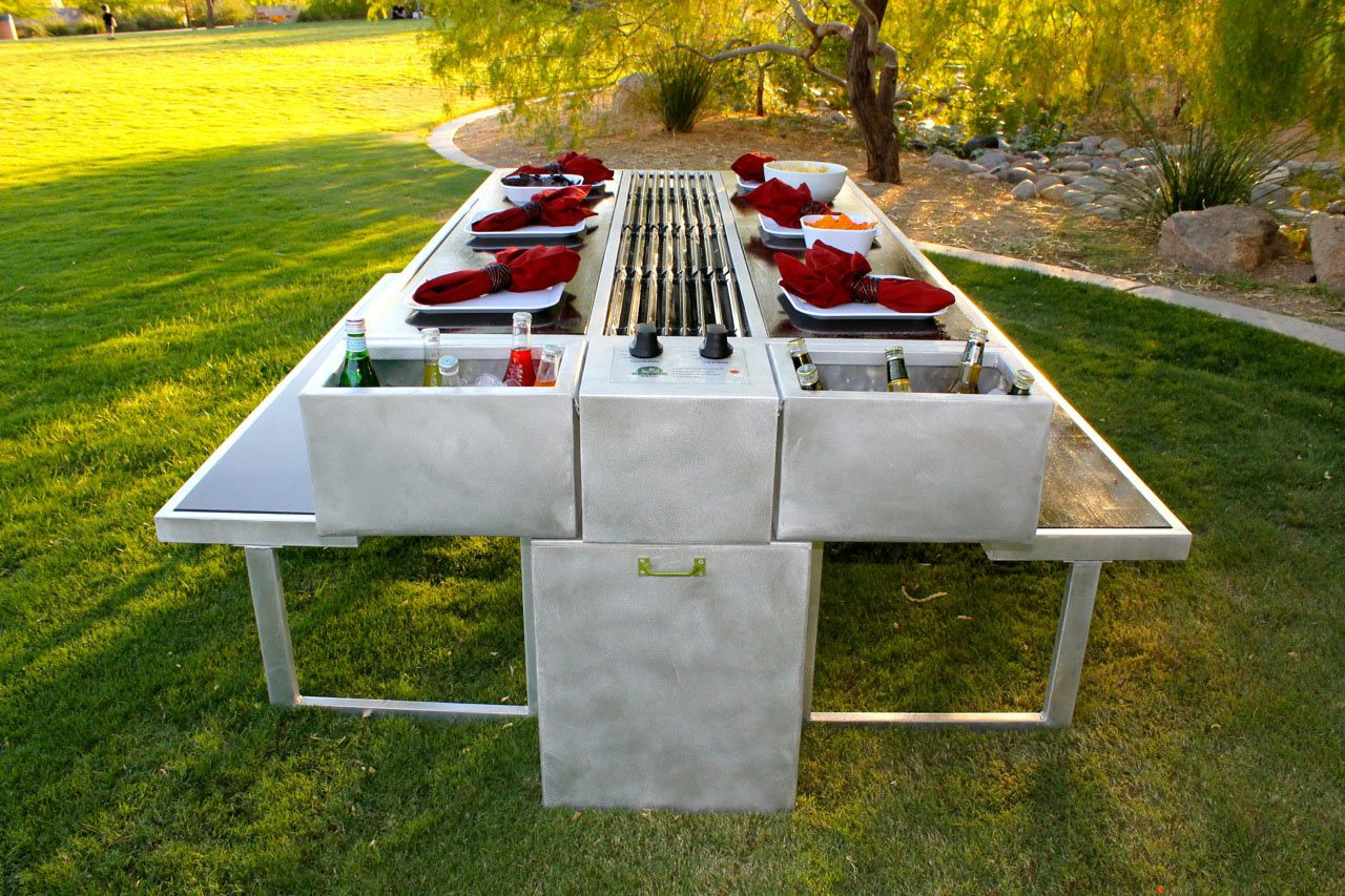 An outdoor grill you can cook and eat at picnic tables for Grilling porch designs