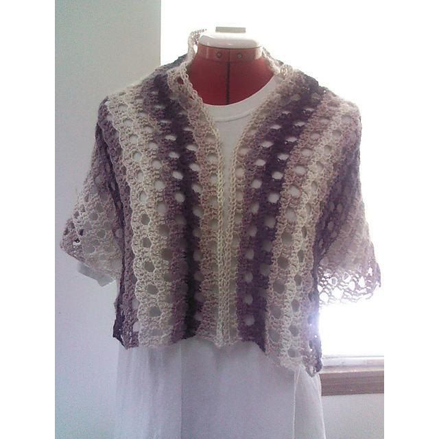"""It is a top-down, asymmetrical, one-piece shawl. You can customise into a bigger size either by using a bigger hook or doing more repeats. This pattern will work with any kind of yarn and colours. Gauge is not important.Purple – Top edge 48"""", Top to bottom 23"""" Cream and brown – 47"""" x 23"""" (lightly felted)Many thanks to JustAli, burgundyb and Taffybloom.Note : You can sell the finished item. Please credit me as the designer. If not, that is fine too. Thank you for crocheting my…"""