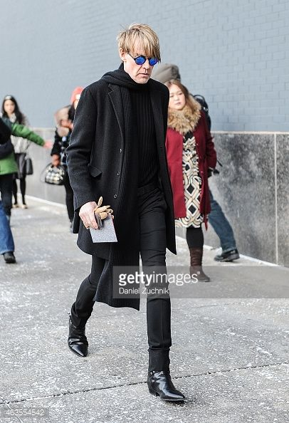 Shop this look on Lookastic:  http://lookastic.com/men/looks/sunglasses-scarf-crew-neck-sweater-overcoat-gloves-dress-pants-chelsea-boots/8733  — Blue Sunglasses  — Black Scarf  — Black Crew-neck Sweater  — Black Overcoat  — Tan Suede Gloves  — Black Dress Pants  — Black Leather Chelsea Boots