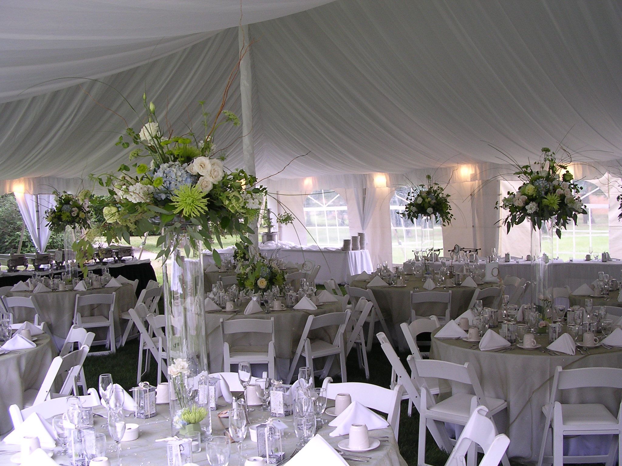 Blue and white wedding decor  mix of tall centerpiece and low centerpieces green white and blue