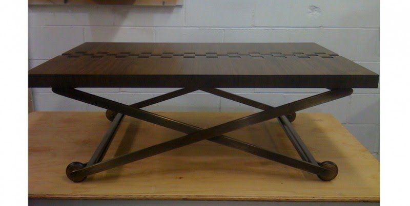 Adjustable height coffee table with antique brass finish