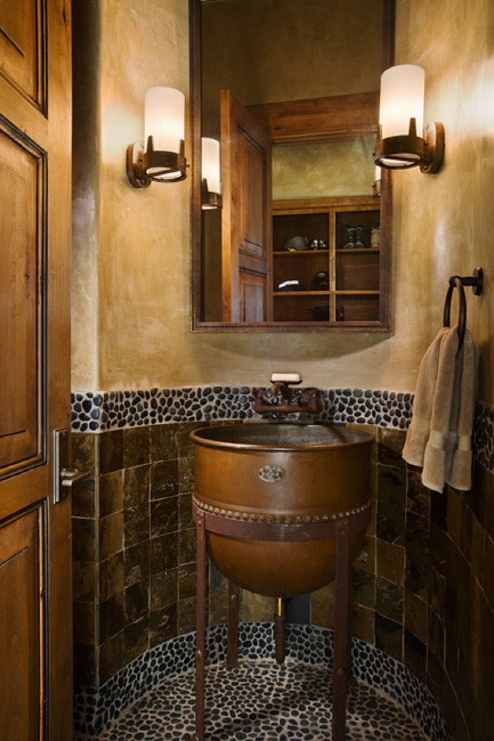 Unique bathroom sink basin with natural stone wall