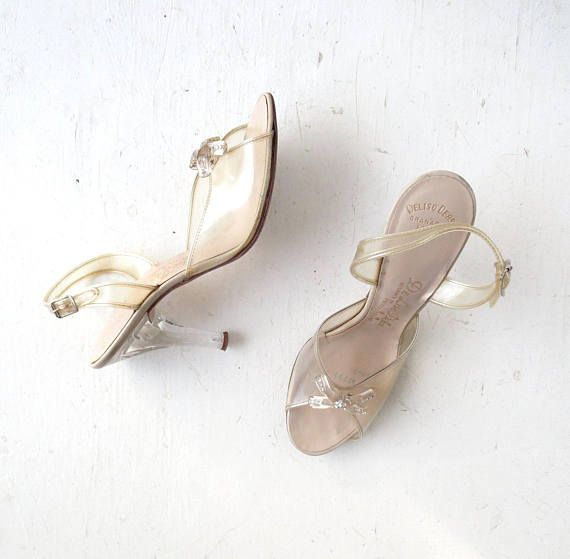 b69d1da30ed4d 1950s clear plastic heels with rhinestone bows and carved Lucite ...
