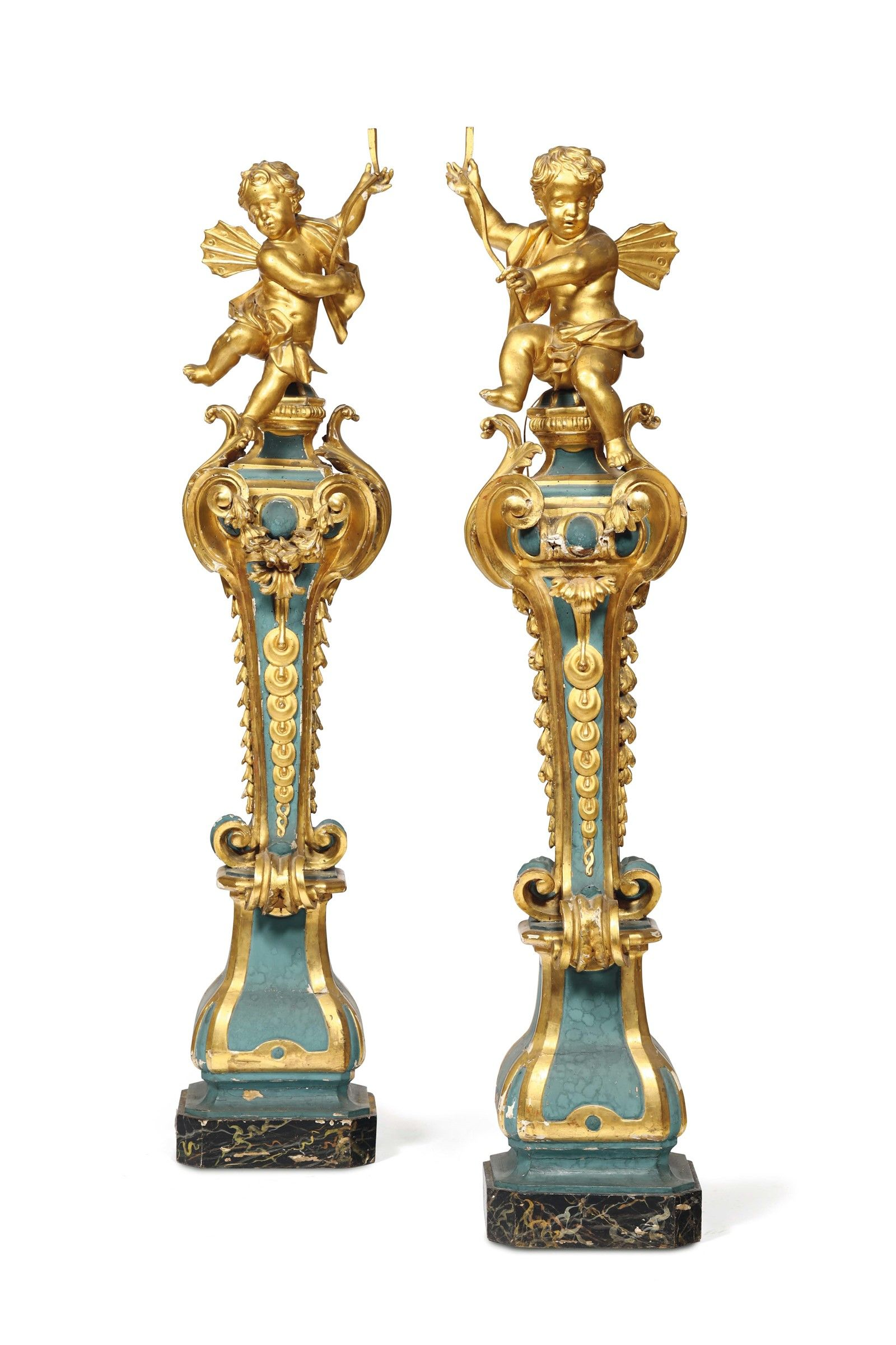 Pair Of Carved Decorative Pedestals Supporting A Cherub