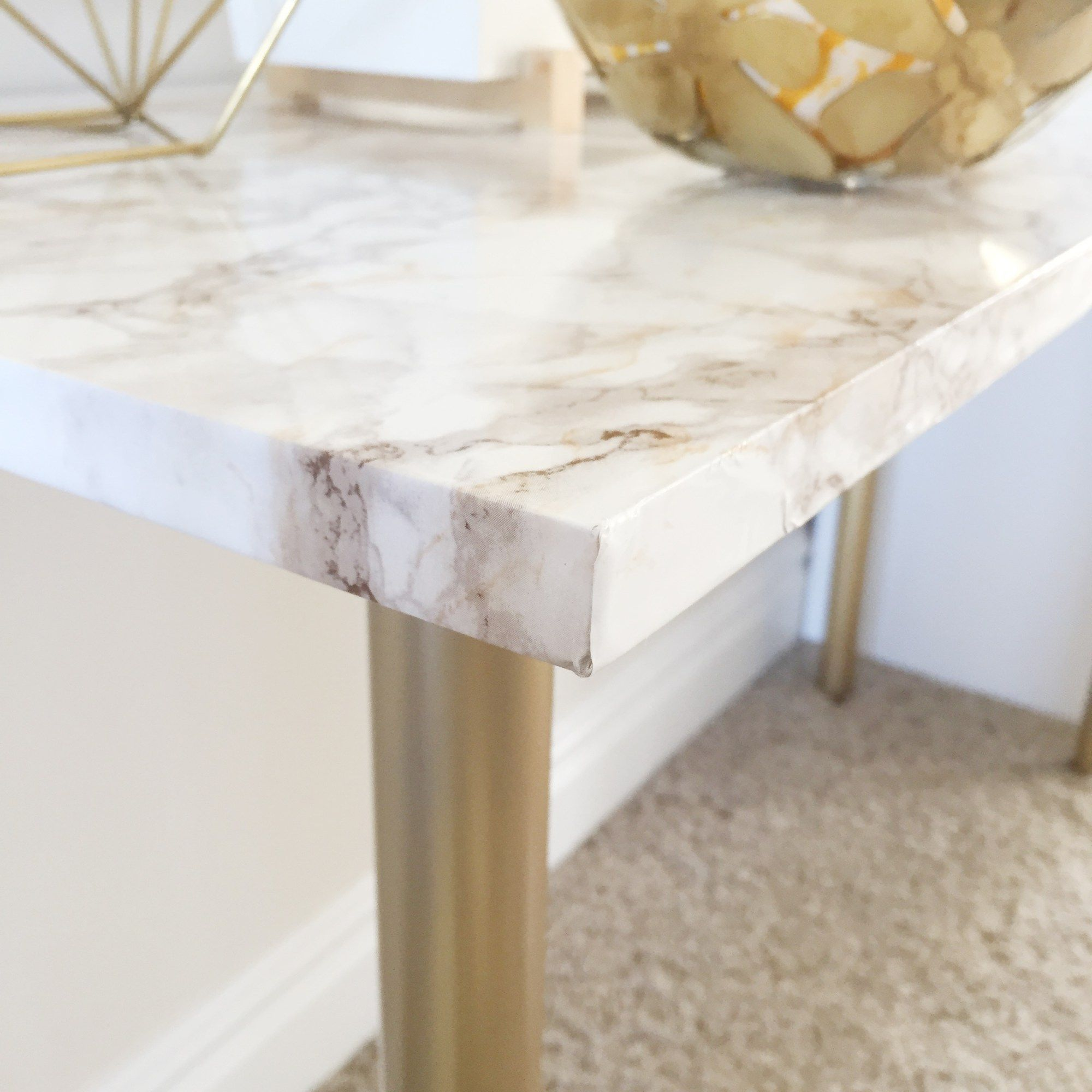 IKEA hack marble table with gold legs and trim